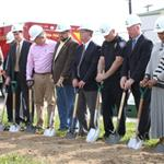 Administrative Employees Breaking Ground with Shov